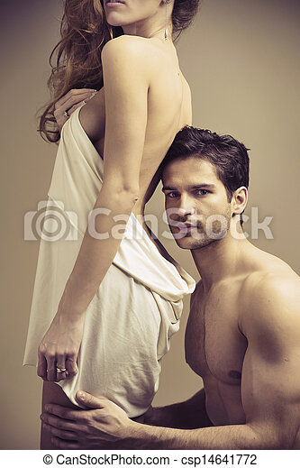 Glad handsome man touching his woman - csp14641772