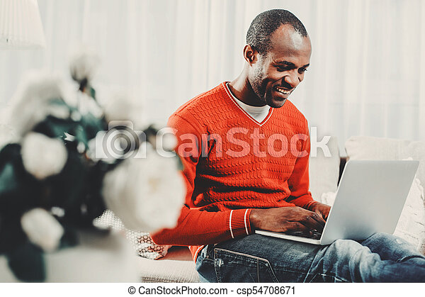 Glad man concentrating on computer screen - csp54708671