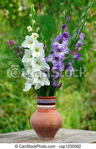 Bunch Of Flowers Gladiolus In Vase At The Garten