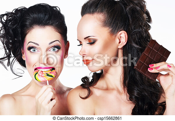 Glam. Couple of Funny Women holding Sweets. Positive Emotions. Vitality - csp15662861