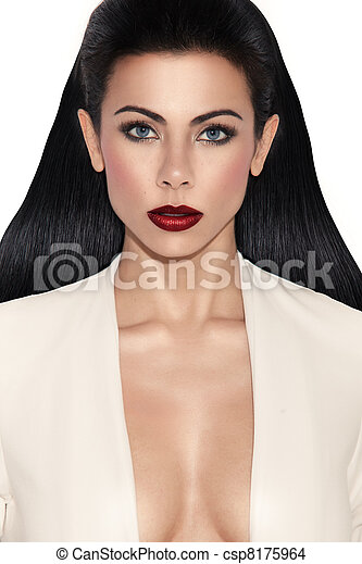 Glamorous busty woman with plunging neckline looking directly at camera, closeup on whiteGlamorous Woman With Plunging Neckline - csp8175964