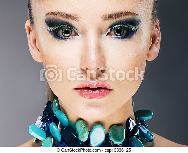 Glamorous Confident Woman in Semi Precious Turquoise Necklace close up - csp13336125