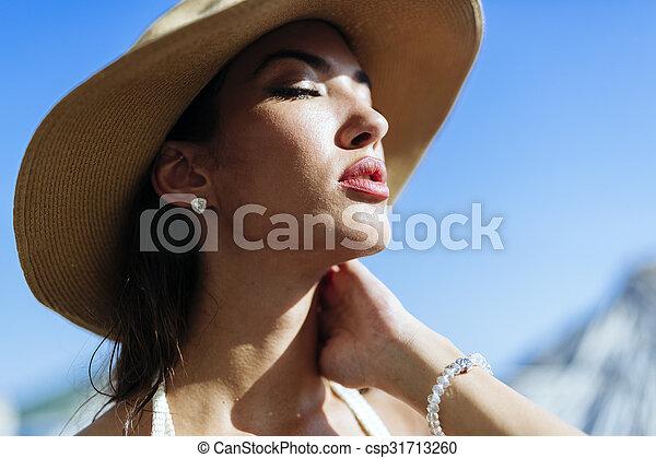 Glamorous woman looking towards the sun - csp31713260