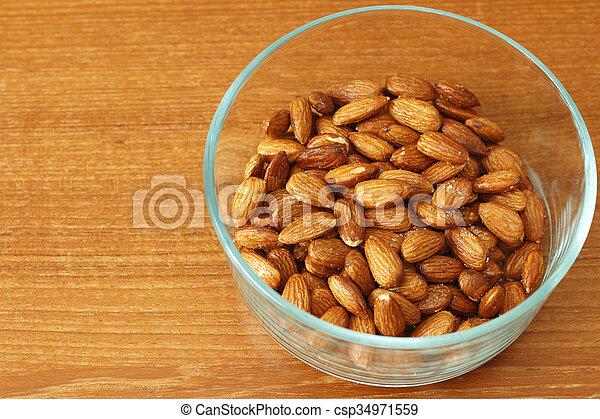 Glass Bowl of Maple Glazed Almonds - csp34971559
