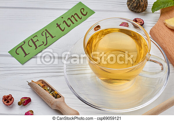 Glass cup of healthy green tea. - csp69059121