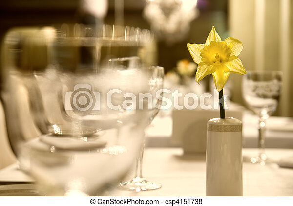 Glass goblets with flower on the table - csp4151738