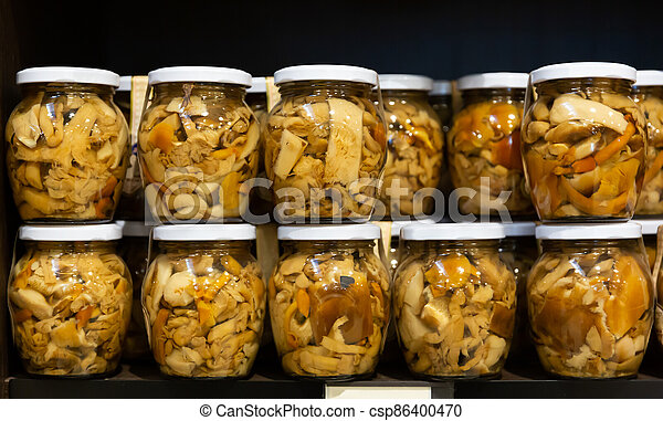Glass jars with pickled mushrooms - csp86400470
