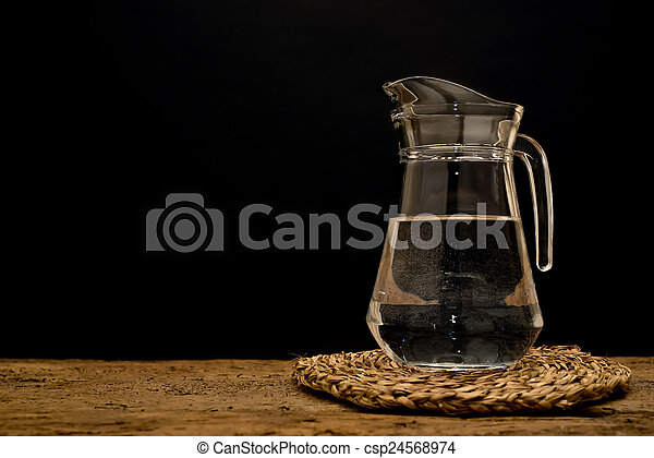 Glass jug with water - csp24568974