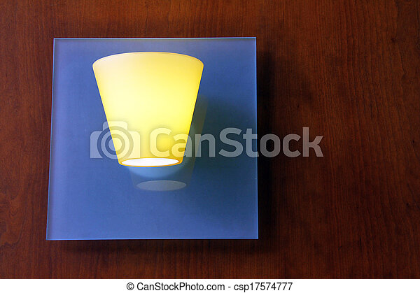 Glass lamp on wooden wall - csp17574777