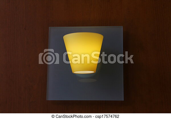 Glass lamp on wooden wall - csp17574762