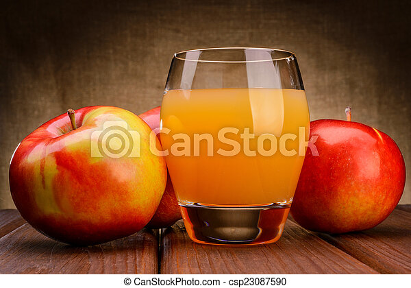 Glass of apple juice with apples - csp23087590