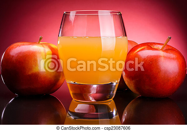 Glass of apple juice with apples - csp23087606