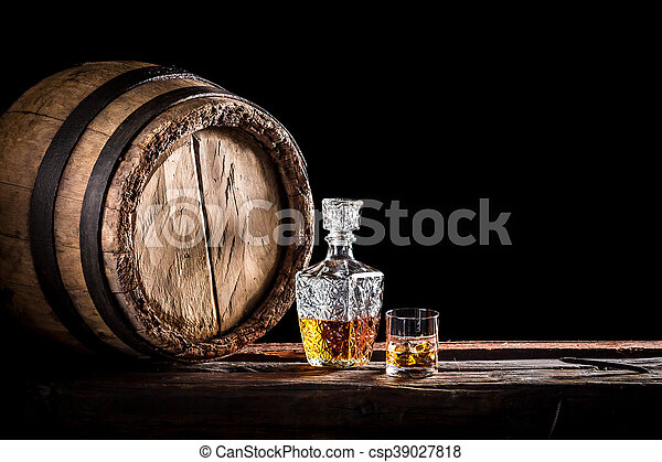 Glass of fine whisky in the distillery basement - csp39027818