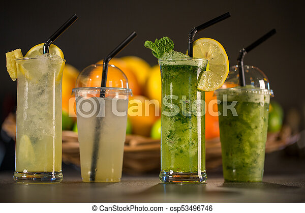Glass of fresh green smoothie made from mint, apple and spinach - csp53496746