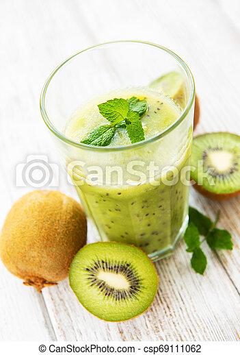 Glass of kiwi smoothie with fresh fruits - csp69111062