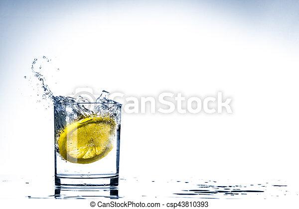 Glass of lemon water - csp43810393