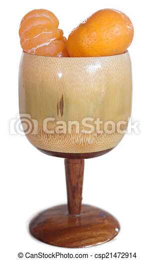 Glass of orange juice made ??from wood isolated. - csp21472914