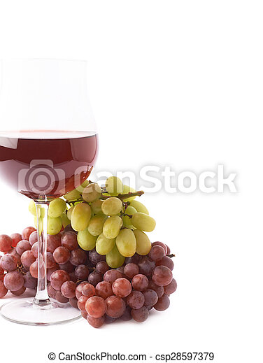 Glass of red wine next to a branch of grapes - csp28597379