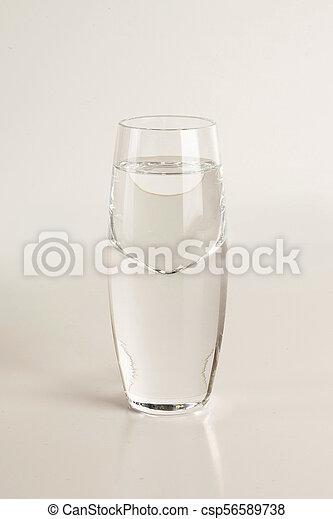 Glass of vodka on light gray background - csp56589738