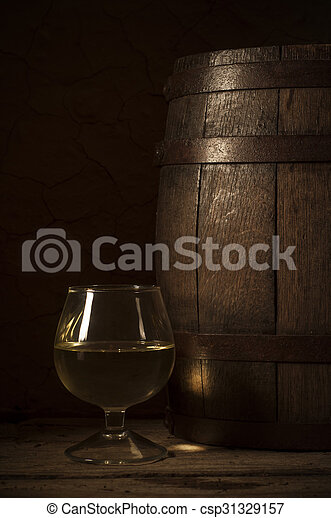 Glass white wine and bunch grapes on background of wooden  - csp31329157