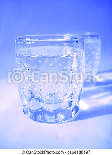 Glass with water in blue color - csp4188197