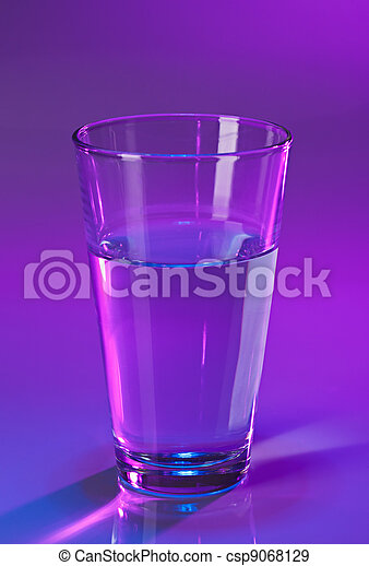 Glass with water on violet background - csp9068129
