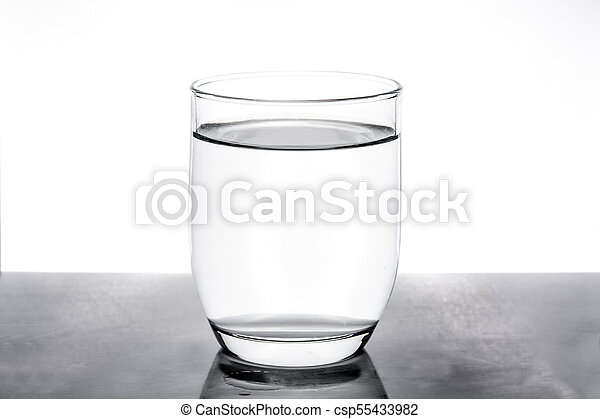 Glass with water on white background - csp55433982