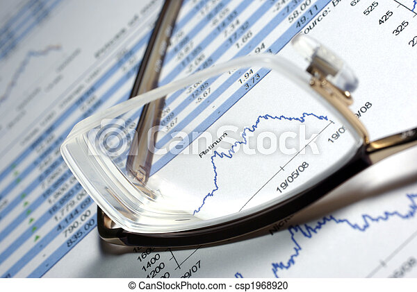 Glasses and printed financial report with data, charts. - csp1968920