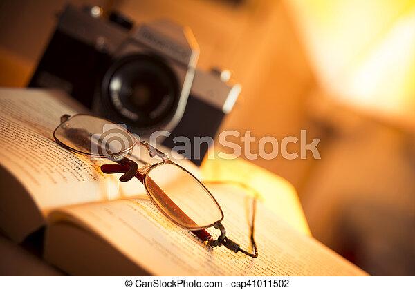 Glasses, book and film camera - csp41011502
