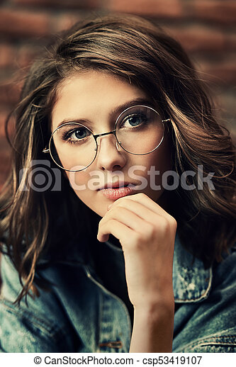df6fe9b455 Glasses for youth. Portrait of a cute girl teenager wearing ...