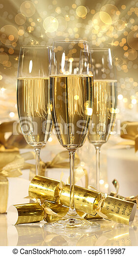 Glasses of champagne and gifts for new years - csp5119987
