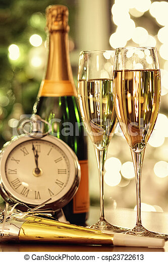 Glasses of champagne with festive background - csp23722613