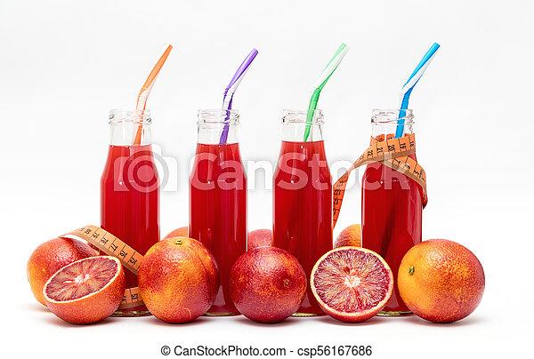 Glasses of fresh pressed blood orange fruit juice - csp56167686