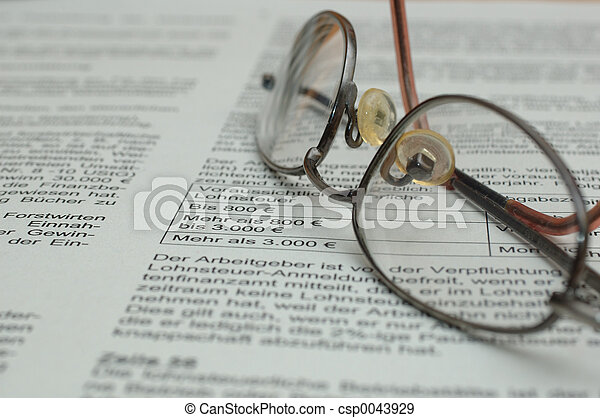 Glasses on business report - csp0043929