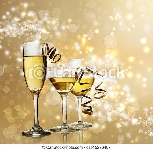 Glasses on Golden Sparkling Background - csp15276407
