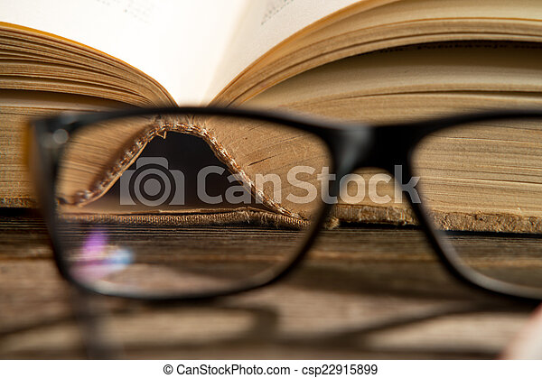 glasses with books - csp22915899