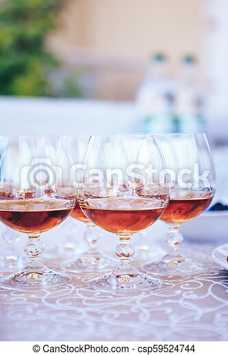 Glasses with brandy on the table - csp59524744