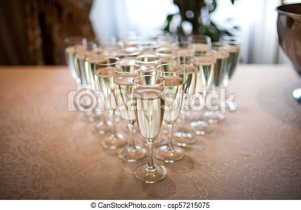 Glasses with champagne on the table - csp57215075