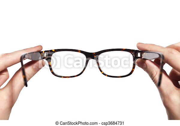 glasses with horn-rimmed in human hands isolated  - csp3684731
