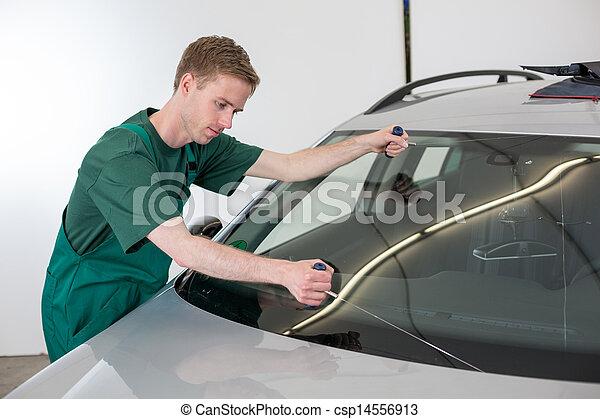 Glazier removing windshield - csp14556913