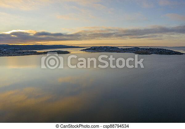 Gloassy sea in winter drone photo - csp88794534