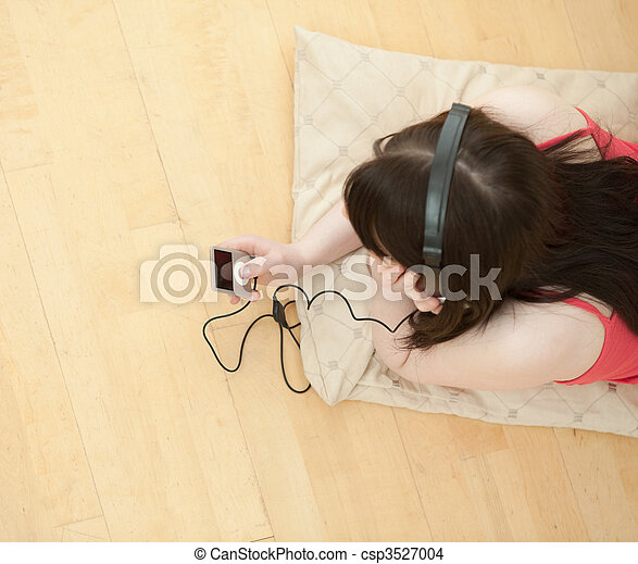 Global view of woman listens music - csp3527004