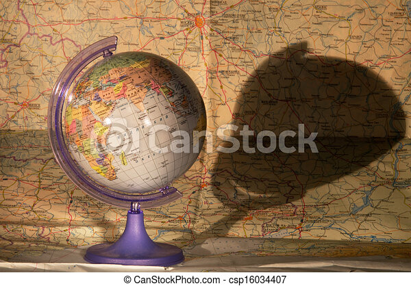 Globe on a map of - csp16034407