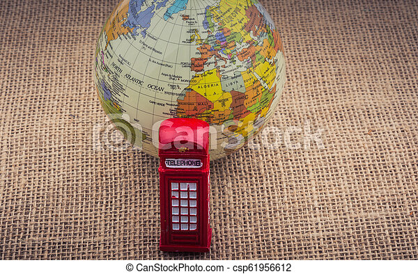 Globe with a telephone booth canvas background - csp61956612