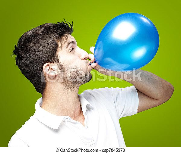 Hombre soplando globo - csp7845370