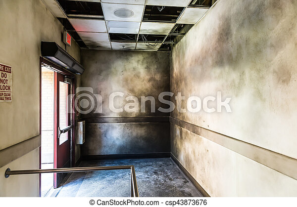 Gloomy burned hall and opened fire exit. - csp43873676