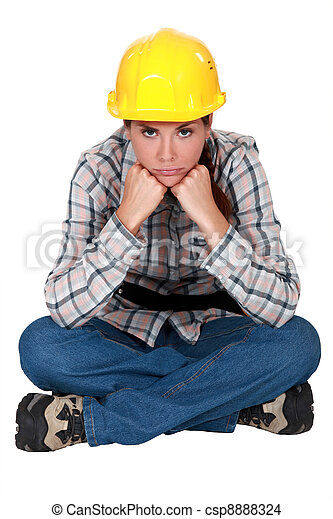 Gloomy female construction worker - csp8888324