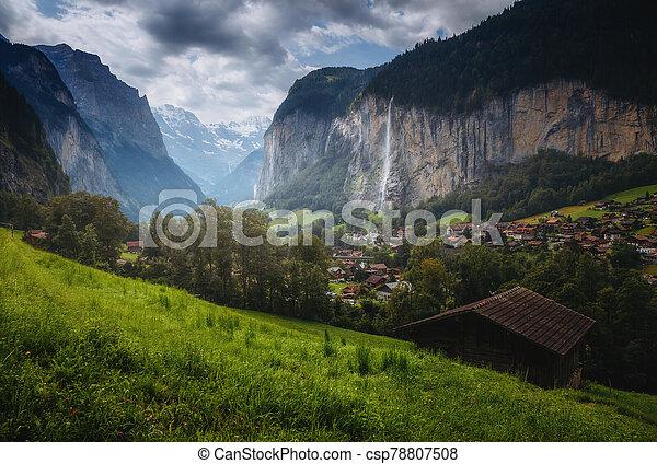 Gloomy view of alpine village. Location place Swiss alps, Lauterbrunnen valley. - csp78807508