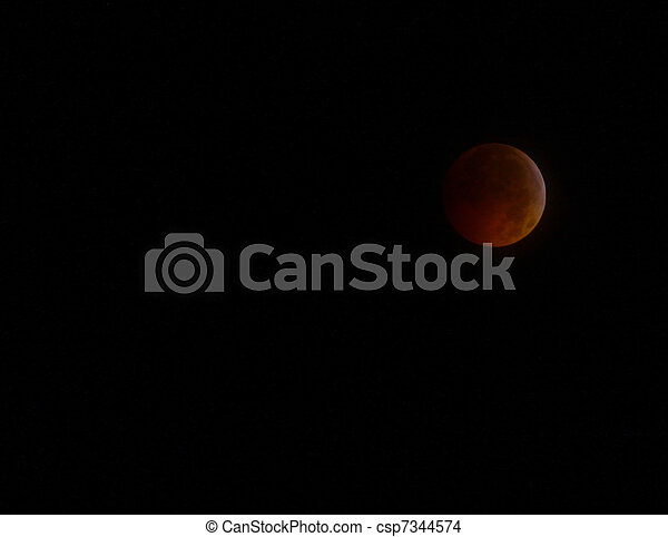 GLOUCESTER - DECEMBER, 21: A Historical Lunar Eclipse coinciding with the Winter Solstice as seen through the clouds in  the night sky on Dec. 21, 2010 in Gloucester Virginia - csp7344574