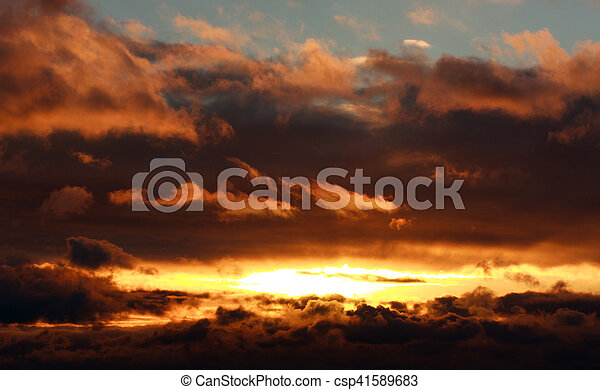 Glowing dramatic sunset clouds in sky, nature background - csp41589683